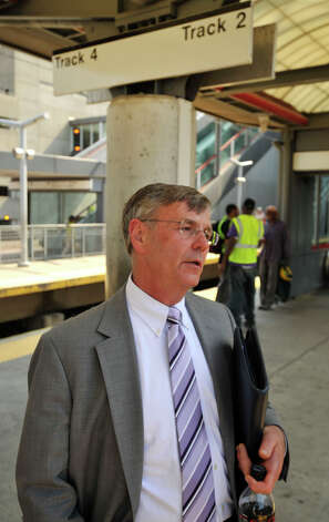 James Redeker, commissioner of the Connecticut Department  of Transportation, waits on a platform on Tuesday, May 21, 2013 in Stamford before boarding the first train to travel through to New Haven since a Metro-North train derailed a week ago. On Tuesday, limited service between Grand Central and New Haven opened up. Officials plan to have a normal full-service schedule on Wednesday. Photo: Jason Rearick / Stamford Advocate