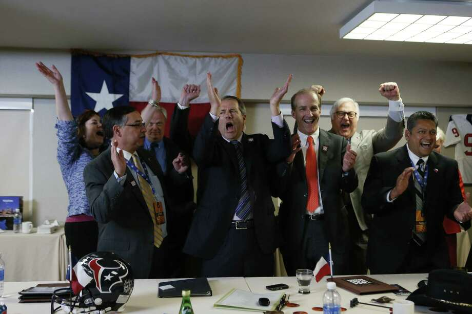Chairman Rick Campo, center, leads the cheers for Houston's Super Bowl committee after the NFL picked the Bayou City on Tuesday. Photo: Damian Strohmeyer, For The Houston Chronicle