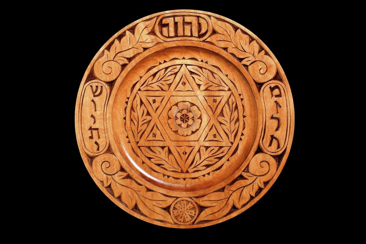 An exhibit of Jewish chip-carver art, by Fairfield's Harvey Paris, is on exhibit at the Easton Public Library through June 30. Above is an example of a Mizrach, which is placed by Jews on eastern walls so they know the direction of Jerusalem.
