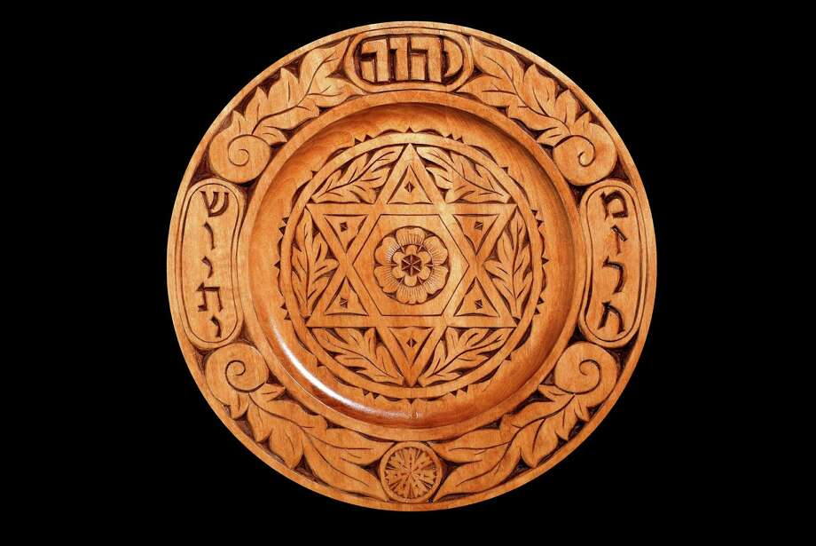 An exhibit of Jewish chip-carver art, by Fairfield's Harvey Paris, is on exhibit at the Easton Public Library through June 30. Above is an example of a Mizrach, which is placed by Jews on eastern walls so they know the direction of Jerusalem. Photo: Contributed Photo / Connecticut Post Contributed