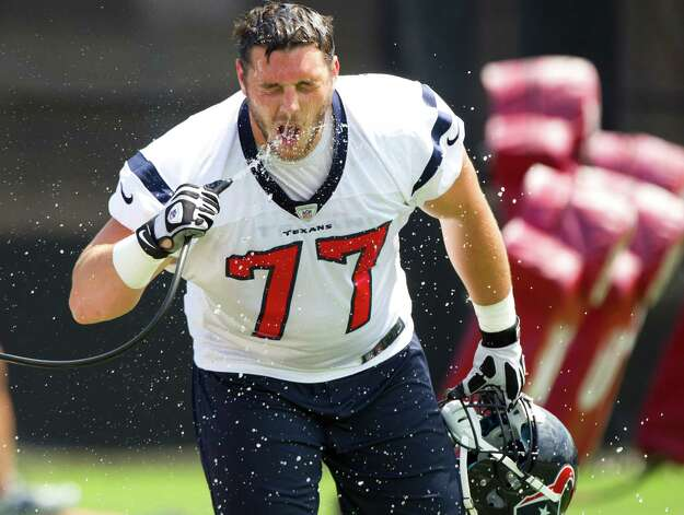 Houston Texans tackle David Quessenberry splashes his face with water while getting a drink during Texans' Organized Team Activities at the Methodist Training Center Tuesday, May 21, 2013, in Houston. Photo: Brett Coomer, Houston Chronicle / © 2013 Houston Chronicle
