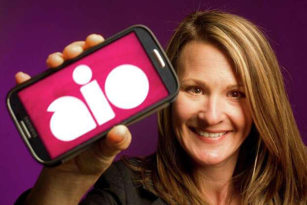 Portrait of Jennifer Van Buskirk, president of Aio Wireless, in the Houston Chronicle studio Tuesday, May 21, 2013, in Houston. Photo: Johnny Hanson, Houston Chronicle / © 2013  Houston Chronicle