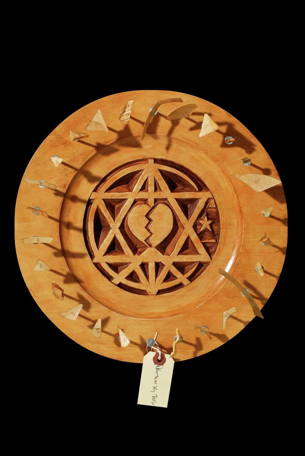 Wood carver Harvey Paris, of Fairfield, created