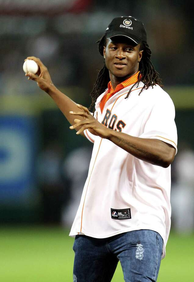 Houston Texans 1st-round draft pick De- Andre Hopkins,  throws out the first pitch before the start of an MLB game at Minute Maid Park, Tuesday, May 21, 2013, in Houston. Photo: Karen Warren, Houston Chronicle / © 2013 Houston Chronicle