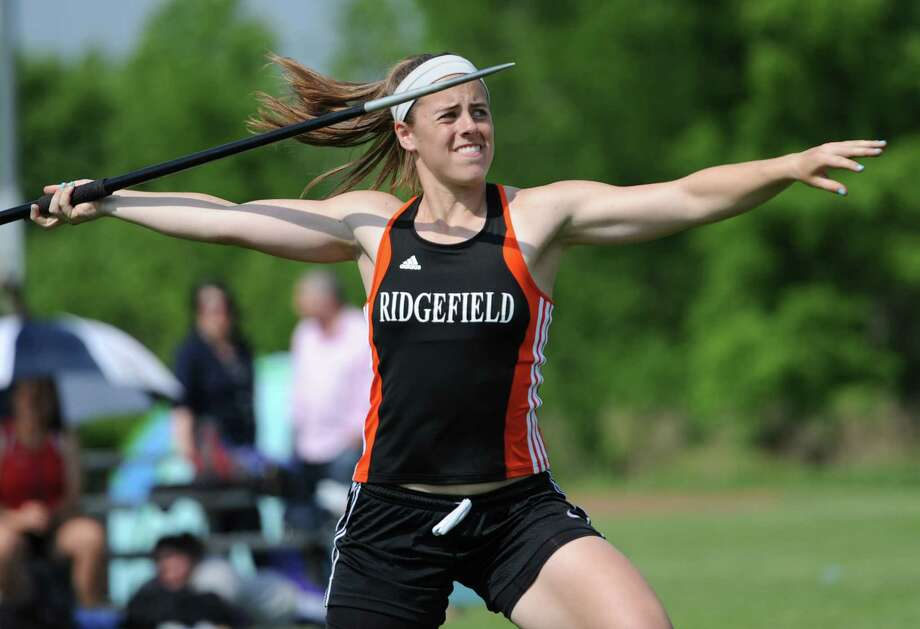 Ridgefield's Ellie Gravitte competes in the girls javelin at the FCIAC Track and Field Championships at Danbury High School in Danbury, Conn. on Tuesday, May 21, 2013.  Gravitte won the event, setting a state and FCIAC meet record, with a throw of 152-07. Photo: Tyler Sizemore / The News-Times