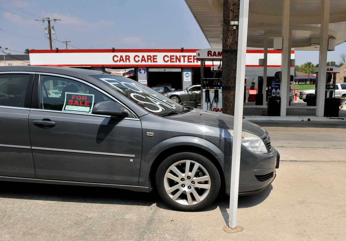 """A used vehicle sits for sale in front of the Ram Service Center at North New Braunfels Avenue and Brees Street in Alamo Heights. Such a practice is known as """"curbstoning"""" and is seen as a distraction to motorists."""