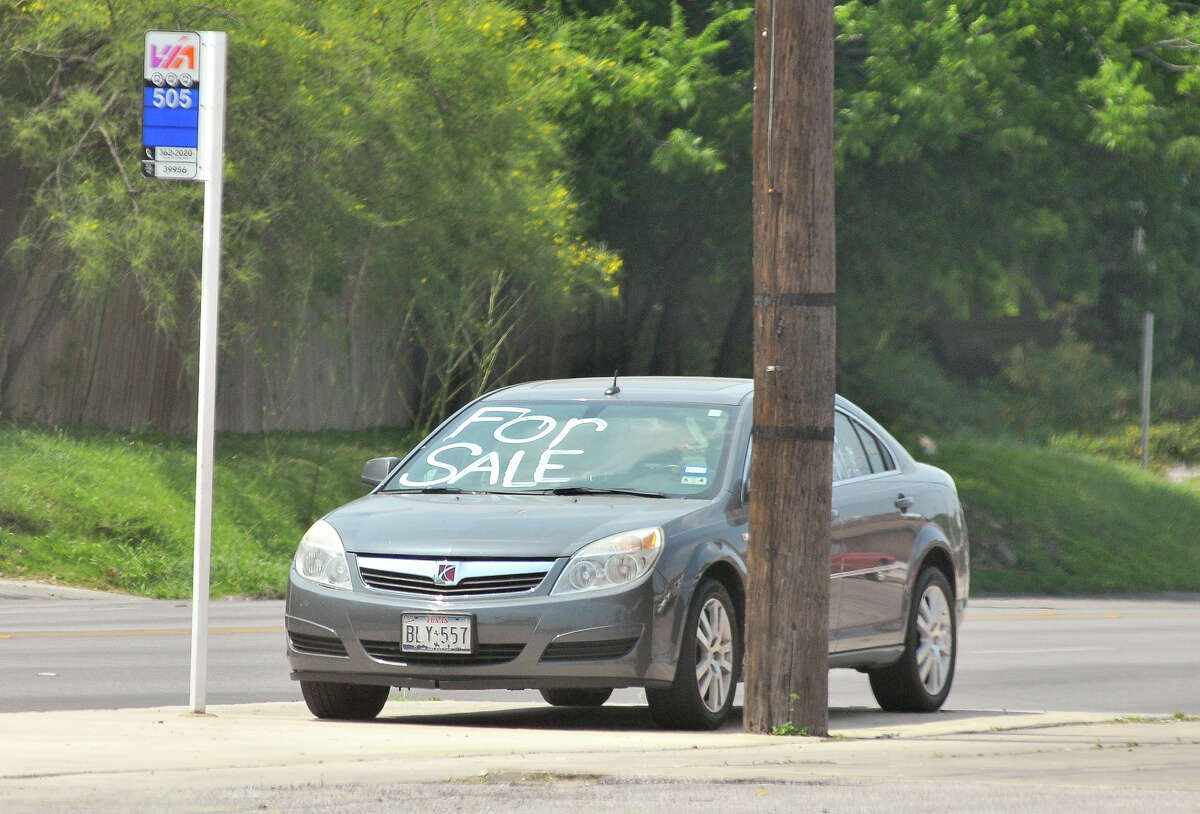 A used vehicle sits for sale in front of the Ram Service Center at the corner of north New Braunfels and Brees St. in Alamo Heights.