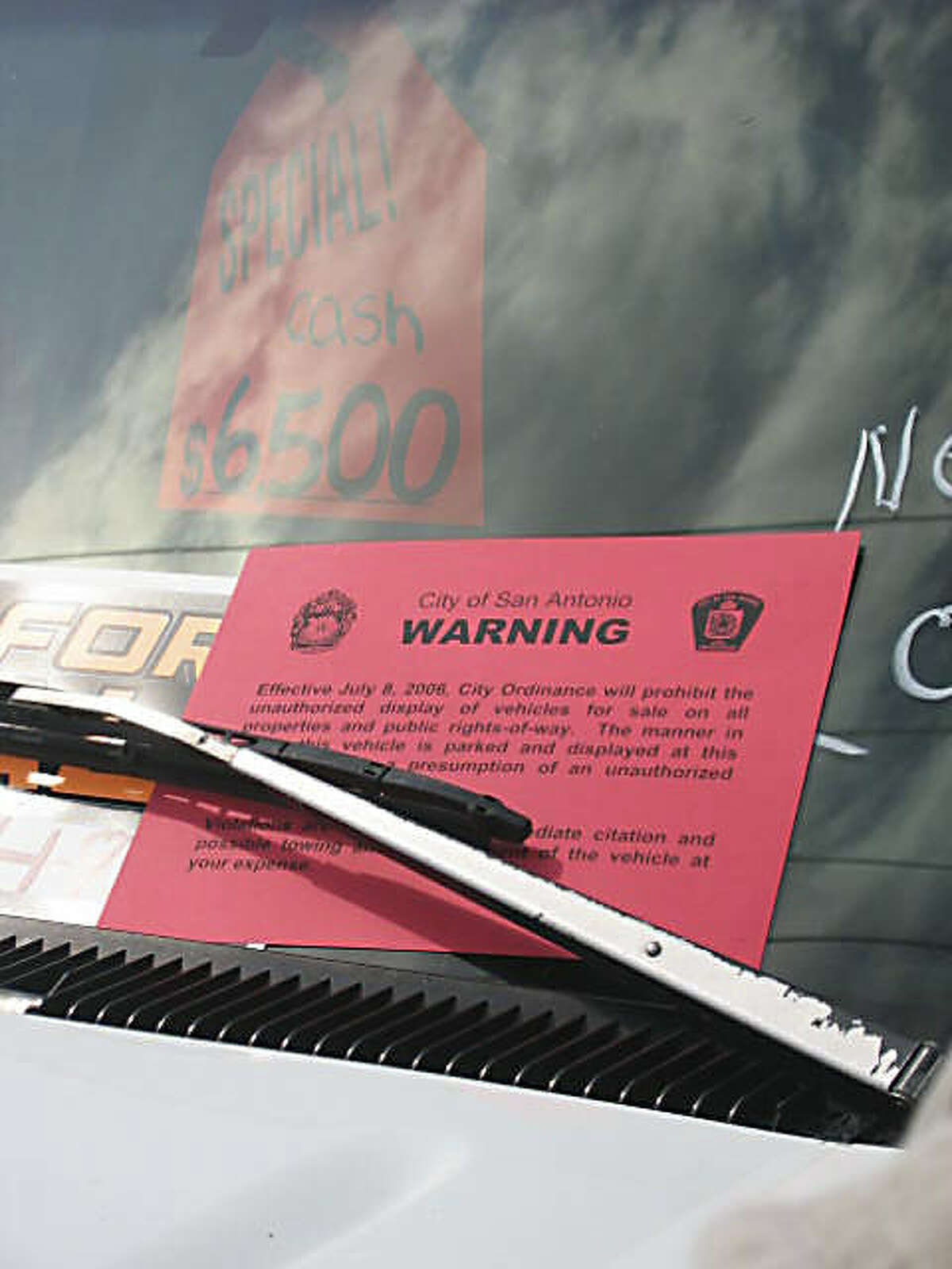 A truck for sale receives a notice warning of a prohibition of the activity.