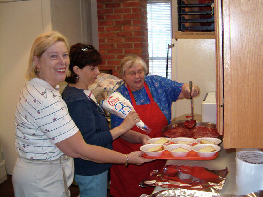 The Brookfield Historical Society will hold its annual Strawberry Festival on Sunday, May 26, after the town's Memorial Day parade. Preparing strawberry shortcake during last year's festival are, left to right, Liz Roberts, Kathy Rajcula and her mom, Elaine Rajcula. Photo: Contributed Photo