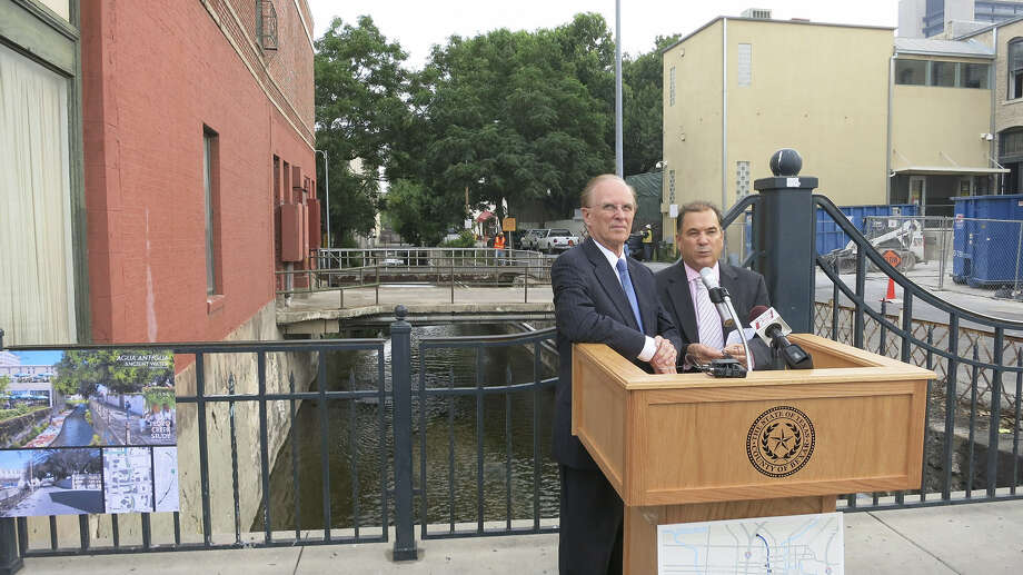 "County Judge Nelson Wolff and Commissioner Sergio ""Chico"" Rodriguez stand over San Pedro Creek at Dolorosa Street to announce the county's $175 million plan for the creek. Photo: John W. Gonzalez / San Antonio Express-News"