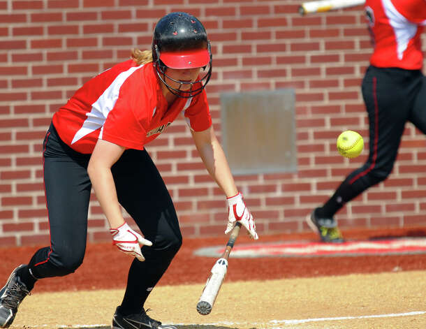 New Canaan's Abby Jenkins hits a bunt, during FCIAC Softball Championship semi-final action against Fairfield Ludlowe at Sacred Heart University in Fairfield, Conn. on Tuesday May 21, 2013. Photo: Christian Abraham / Connecticut Post