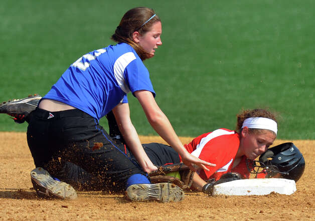 Fairfield Ludlowe's Emily Nelson tags out New Canaan's Marlee Ready at second, during FCIAC Softball Championship semi-final action at Sacred Heart University in Fairfield, Conn. on Tuesday May 21, 2013. Photo: Christian Abraham / Connecticut Post