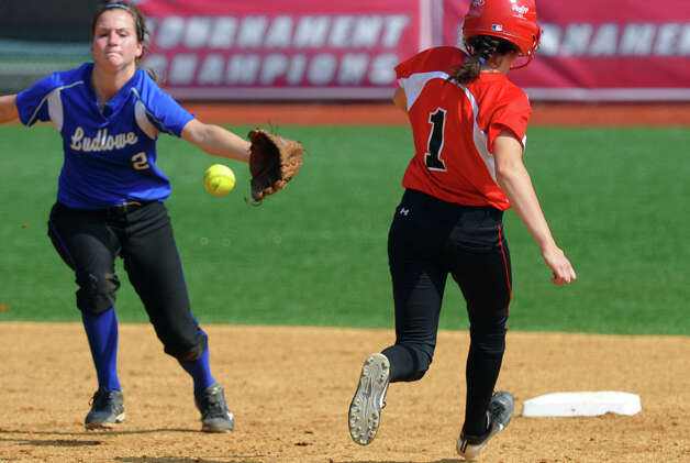 New Canaan's Claire Conley heads to second as Fairfield Ludlowe's Emily Nelson catches the ball, during FCIAC Softball Championship semi-final action at Sacred Heart University in Fairfield, Conn. on Tuesday May 21, 2013. Photo: Christian Abraham / Connecticut Post