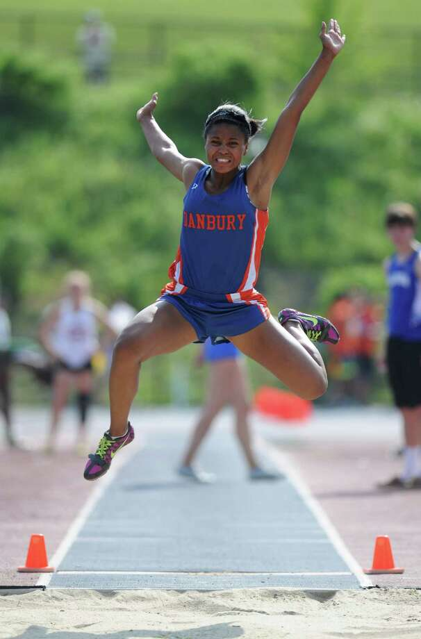 Danbury's Naomi Lowry competes in the girls long jump at the FCIAC Track and Field Championships at Danbury High School in Danbury, Conn. on Tuesday, May 21, 2013.  Lowry placed second in the event. Photo: Tyler Sizemore / The News-Times