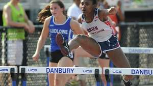 Brien McMahon's Sarah Boyd competes in the girls 100 meter hurdles final at the FCIAC Track and Field Championships at Danbury High School in Danbury, Conn. on Tuesday, May 21, 2013.  Boyd won the event with a time of 15.42.