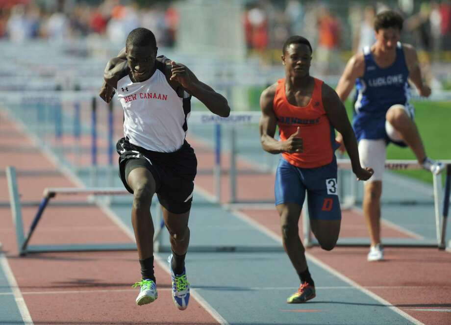 New Canaan's Devaun Bovell, left, edges out Danbury's Akim Moffet to win the boys 110 meter high hurdles final at the FCIAC Track and Field Championships at Danbury High School in Danbury, Conn. on Tuesday, May 21, 2013. Photo: Tyler Sizemore / The News-Times