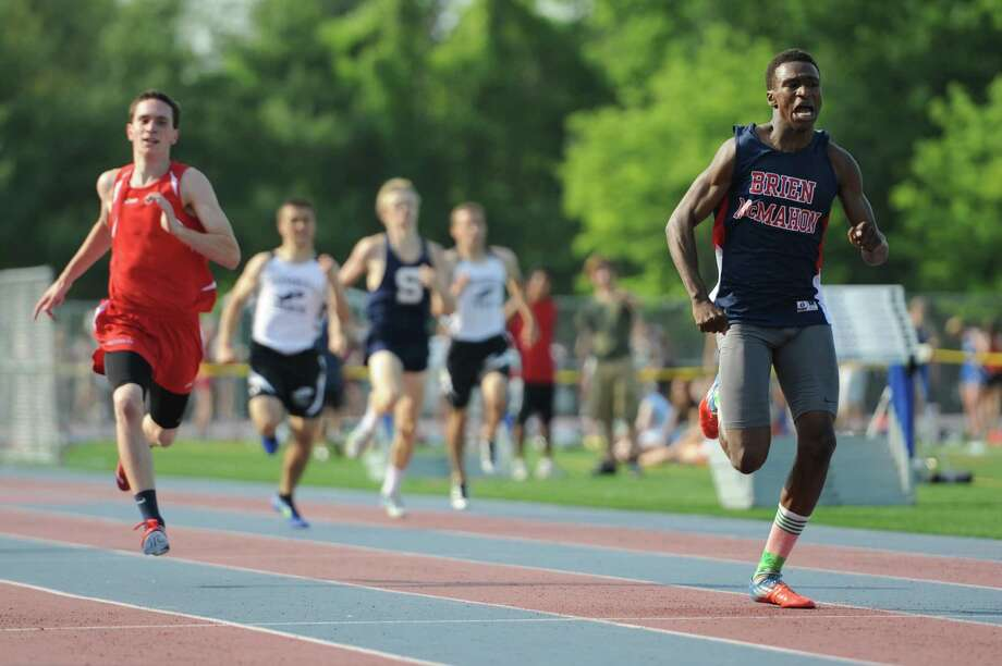 Brien McMahon's Schnyden Pierre wins the boys 400 meter dash final at the FCIAC Track and Field Championships at Danbury High School in Danbury, Conn. on Tuesday, May 21, 2013. Photo: Tyler Sizemore / The News-Times