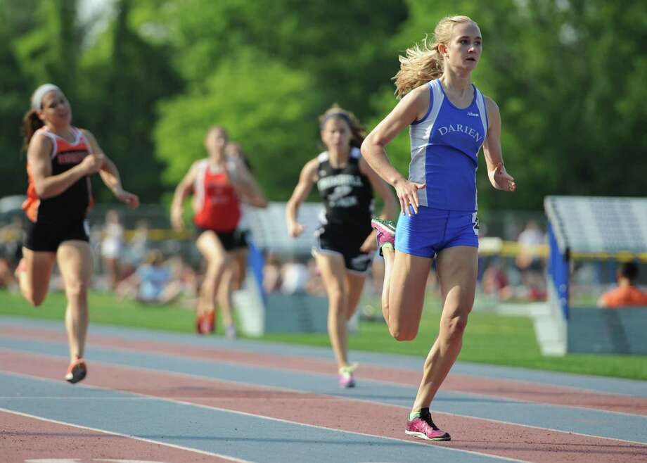 Darien's Anna Sulger, right, wins the girls 400 meter dash at the FCIAC Track and Field Championships at Danbury High School in Danbury, Conn. on Tuesday, May 21, 2013. Photo: Tyler Sizemore / The News-Times