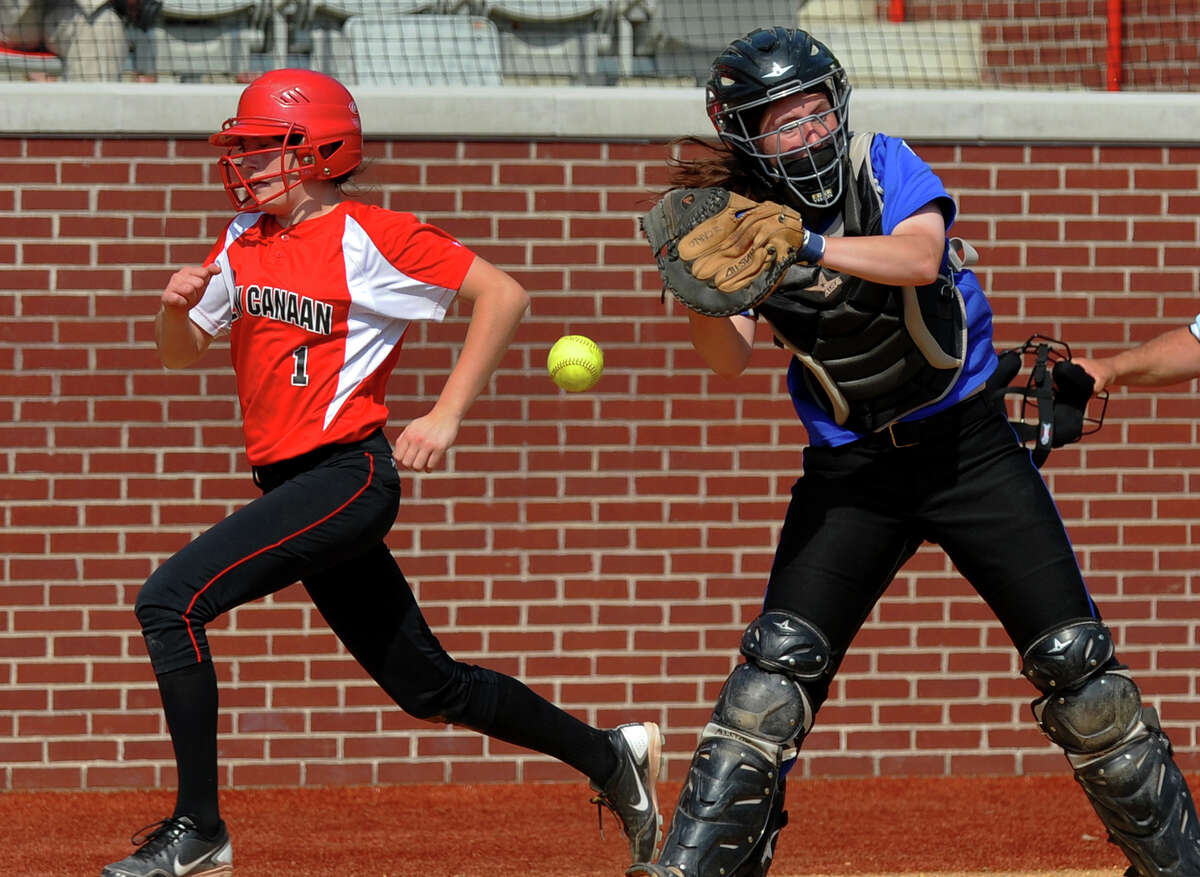 New Canaan's Claire Conley gets past Fairfield Ludlowe catcher Katie Decarlo to score a run, during FCIAC Softball Championship semi-final action at Sacred Heart University in Fairfield, Conn. on Tuesday May 21, 2013.