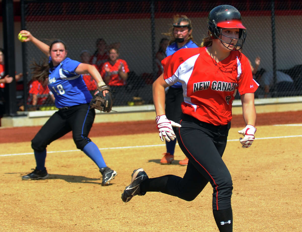 New Canaan's Abby Jenkins heads to first as Fairfield Ludlowe's Brenna Martini fields the ball, during FCIAC Softball Championship semi-final action at Sacred Heart University in Fairfield, Conn. on Tuesday May 21, 2013.
