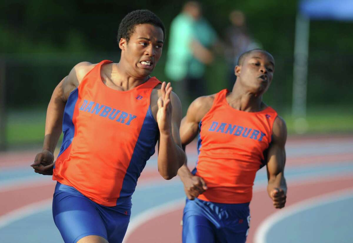 Danbury's Micaiah Hill, left, and Cyrus Brown compete in the boys 200 meter dash final at the FCIAC Track and Field Championships at Danbury High School in Danbury, Conn. on Tuesday, May 21, 2013. Hill finished second and Brown finished fifth.