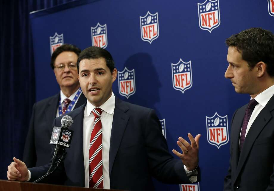 San Francisco 49ers football team CEO Jed York speaks as bid chairman Daniel Lurie, right, and team owner John York, left, listen during a news conference at the NFL spring meeting in Boston, Tuesday, May 21, 2013, discussing their successful bid to host Super Bowl 2016. (AP Photo/Elise Amendola) Photo: Elise Amendola, Associated Press
