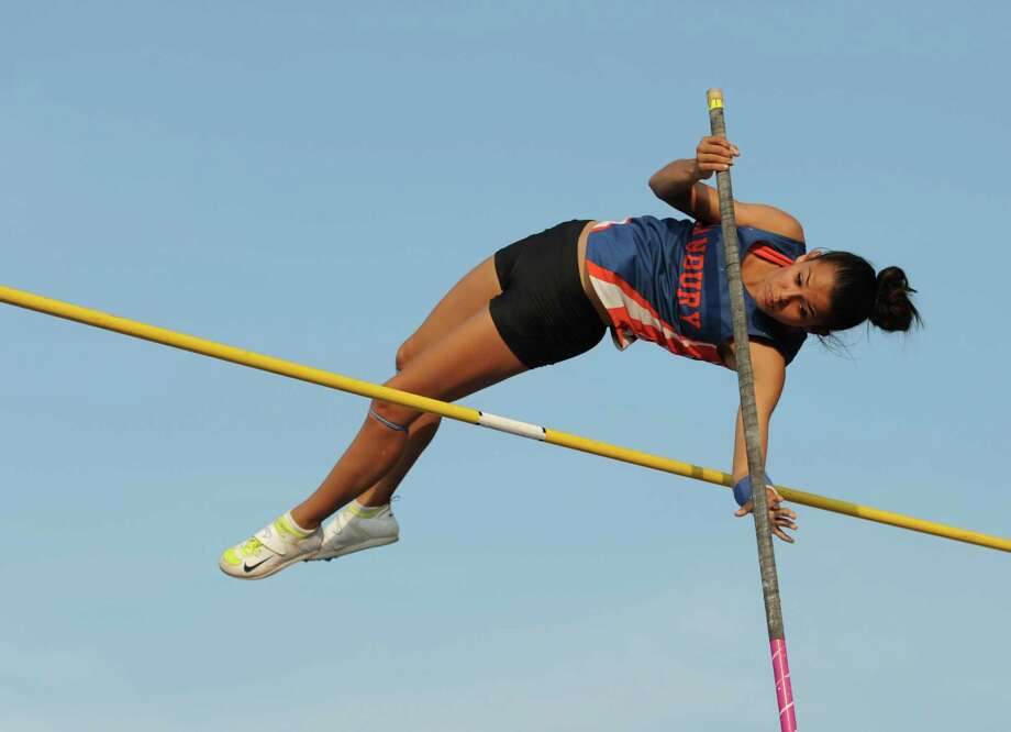 Danbury's Lyzandra Fernandes competes in the girls pole vault at the FCIAC Track and Field Championships at Danbury High School in Danbury, Conn. on Tuesday, May 21, 2013.  Fernandes finished third in the event. Photo: Tyler Sizemore / The News-Times