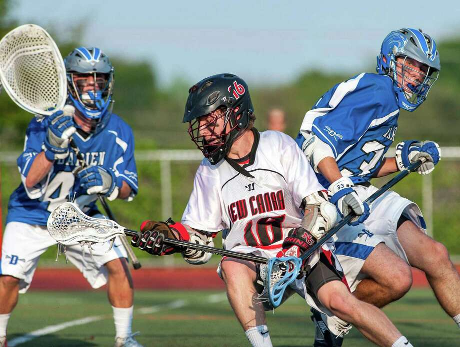 New Canaan high school's Harry Stanton tries to get by Darien high school's Kyle Gifford during an FCIAC boys lacrosse semifinal game played at Brien McMahon high school, Norwalk, CT on Tuesday May 21st. 2013. Photo: Mark Conrad / Stamford Advocate Freelance