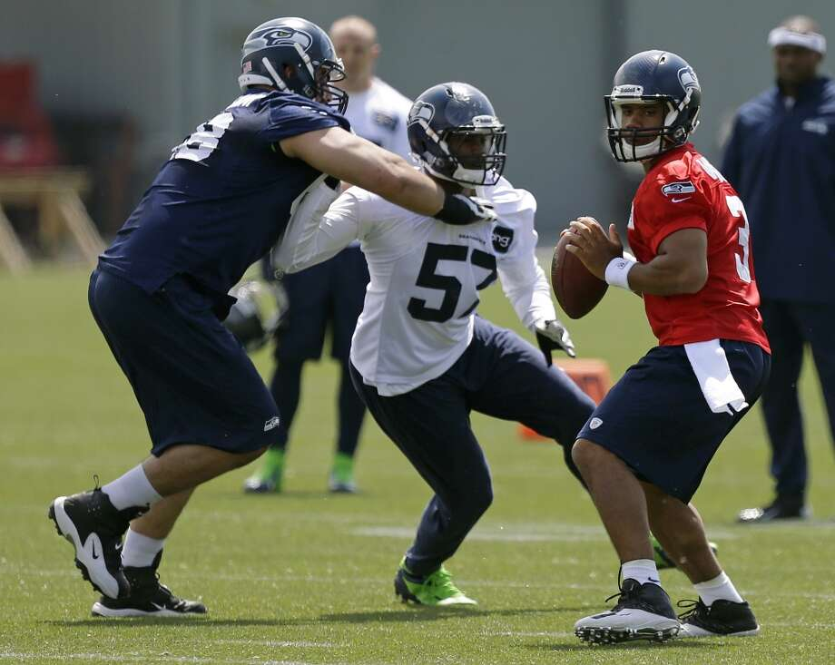 Russell Wilson on the start of Seahawks OTAs  Offseason workouts officially started Monday for the Seahawks with the first OTA, or organized team activity, at the VMAC in Renton. While star running back Marshawn Lynch was notably absent from the first voluntary practice, the Seahawks got a jump start on fielding the best team they can for the 2013 season -- though not without some off-field distractions. Starting quarterback Russell Wilson, about to begin his second year in the NFL, spoke with media during Monday's OTA. Click through the gallery to see what he said.   On how nice it was to get started with his teammates:  ''It's great to be back out here -- a lot of energy today, a lot of great work today. The defense looks good flying around, the offense looks good -- there's nothing better than playing the game of football.''