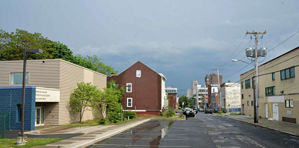 Sherman Ave, entrance to Sheridan Prep Elementary School, left, and the rear of 145 Central Ave., at