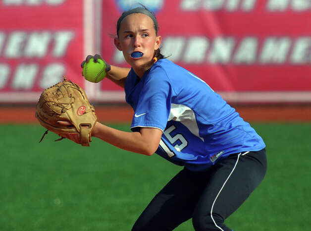 Darien's Avery Maley prepares to throw to first, during FCIAC Softball Championship semi-final action against St. Joseph at Sacred Heart University in Fairfield, Conn. on Tuesday May 21, 2013. Photo: Christian Abraham / Connecticut Post