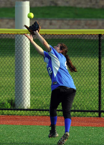 Darien's Emily Moscatello catches a pop fly, during FCIAC Softball Championship semi-final action against St. Joseph at Sacred Heart University in Fairfield, Conn. on Tuesday May 21, 2013. Photo: Christian Abraham / Connecticut Post