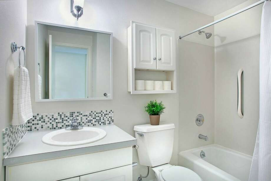 Apartment bathroom of 2865 S. Atlantic St. The 2,590-square-foot house, built in 1994, has four bedrooms and three bathrooms, a deck, a patio and a two-car garage on a 4,000-square-foot corner lot. It's listed for $659,000. Photo: Gregory White Photography/Courtesy Kari Collins, Keller Williams Realty