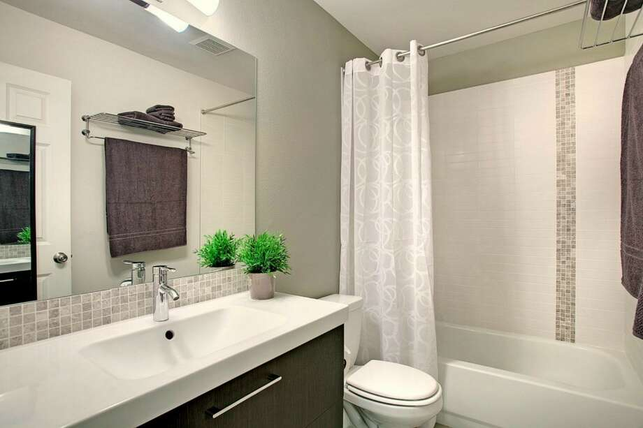 Bathroom of 2865 S. Atlantic St. The 2,590-square-foot house, built in 1994, has four bedrooms and three bathrooms, including a separate apartment, a deck, a patio and a two-car garage on a 4,000-square-foot corner lot. It's listed for $659,000. Photo: Gregory White Photography/Courtesy Kari Collins, Keller Williams Realty