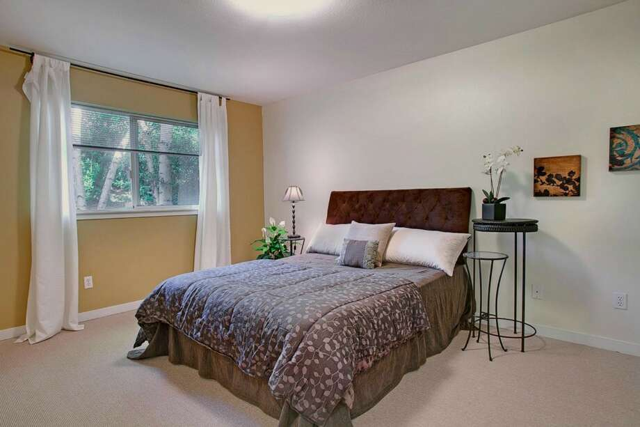 Bedroom of 2865 S. Atlantic St. The 2,590-square-foot house, built in 1994, has four bedrooms and three bathrooms, including a separate apartment, a deck, a patio and a two-car garage on a 4,000-square-foot corner lot. It's listed for $659,000. Photo: Gregory White Photography/Courtesy Kari Collins, Keller Williams Realty