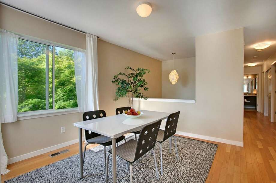 Dining room of 2865 S. Atlantic St. The 2,590-square-foot house, built in 1994, has four bedrooms and three bathrooms, including a separate apartment, a deck, a patio and a two-car garage on a 4,000-square-foot corner lot. It's listed for $659,000. Photo: Gregory White Photography/Courtesy Kari Collins, Keller Williams Realty