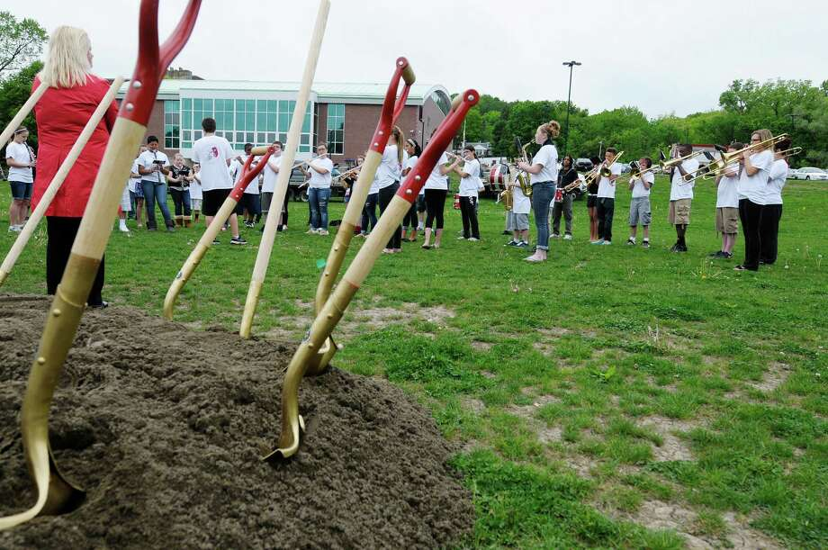 XXX during a ground breaking ceremony at the Watervliet Junior-Senior High School on Monday, May 20, 2013 in Watervliet, NY.  The ceremony was held to mark the start of Phase IV of the district?s building project, which will include a synthetic-turf playing field and a six-lane track with an eight-lane straight away track.  (Paul Buckowski / Times Union) Photo: Paul Buckowski
