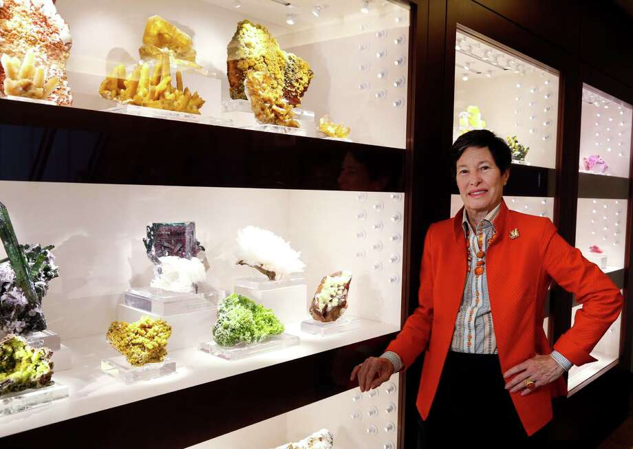 Lyda Hill stands beside her mineral and gem collection in her Dallas office. Her gift to M.D. Anderson continues the long tradition of oil money benefitting the Texas Medical Center. Photo: David Woo, The Dallas Morning News / 10016162A