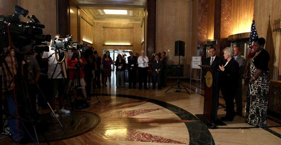 Mayor Annise Parker speaks to the media in the City Hall Rotunda, regarding the announcement that Houston will host Super Bowl LI.
