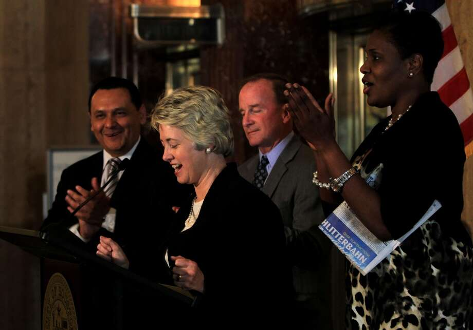 Council members Mayor Pro-Tem Ed Gonzalez, Dave Martin, and Wanda Adams applaud as Mayor Annise Parker speaks to the media in the City Hall Rotunda, regarding the announcement that Houston will host Super Bowl LI.