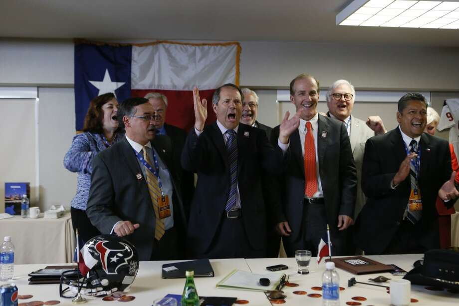 Members of the Houston Super Bowl 2017 committee celebrate after succeeding in their bid for the 51st Super Bowl. Chairman Rick Campo leads the cheers he is surrounded by committee members Katy Caldwell, Edgar Colon, Mark Miller, David Crane, Greg Ortale, and John Solis.