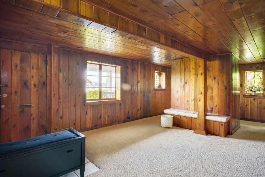 Rec room of 1525 36th Ave. S. The 1,920-square-foot home, built in 1926, has three bedrooms, one bathroom, a porch, decks, a two-car garage and views of Lake Washington and Mount Rainier on a 6,900-square-foot lot. It's listed for $669,000. Photo: Courtesy Kathryn Hinds, Windermere Real Estate