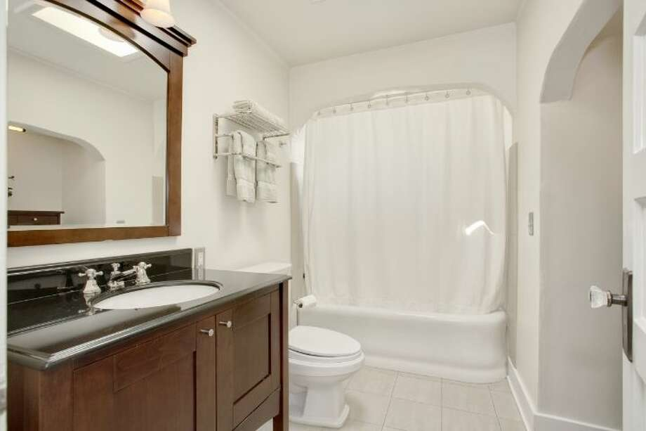 Bathroom of 1525 36th Ave. S. The 1,920-square-foot home, built in 1926, has three bedrooms, one bathroom, a rec room, a porch, decks, a two-car garage and views of Lake Washington and Mount Rainier on a 6,900-square-foot lot. It's listed for $669,000. Photo: Courtesy Kathryn Hinds, Windermere Real Estate