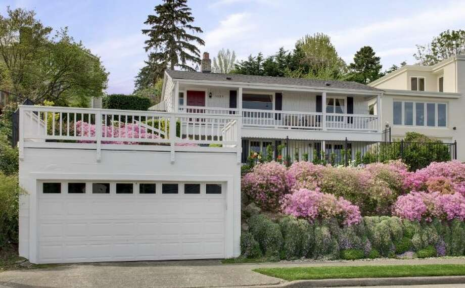 At the middle of our price range is 1525 36th Ave. S. The 1,920-square-foot home, built in 1926, has three bedrooms, one bathroom, a rec room, a porch, decks, a two-car garage and views of Lake Washington and Mount Rainier on a 6,900-square-foot lot. It's listed for $669,000. Photo: Courtesy Kathryn Hinds, Windermere Real Estate