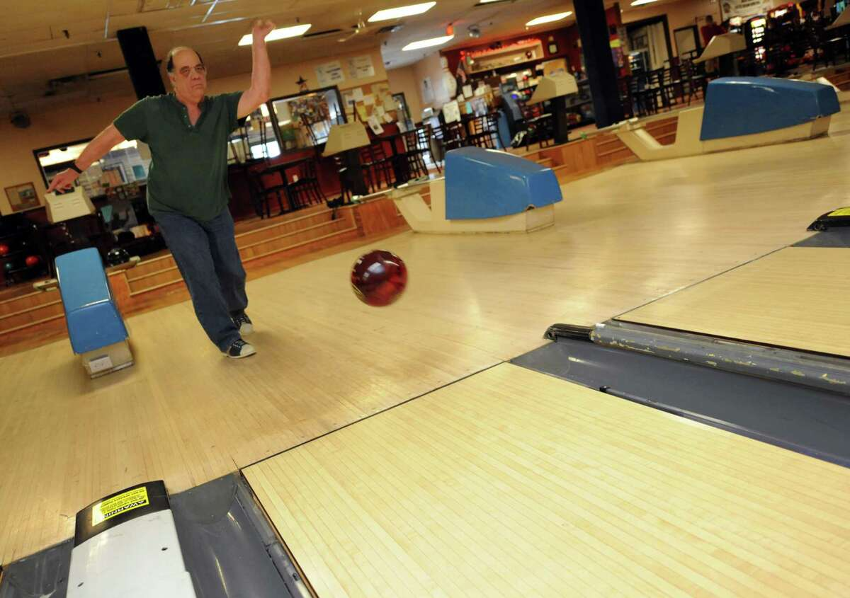 Jay Secor of Guilderland bowls at Town and Country lanes on Tuesday May 21, 2013 in Guilderland, N.Y. (Michael P. Farrell/Times Union)