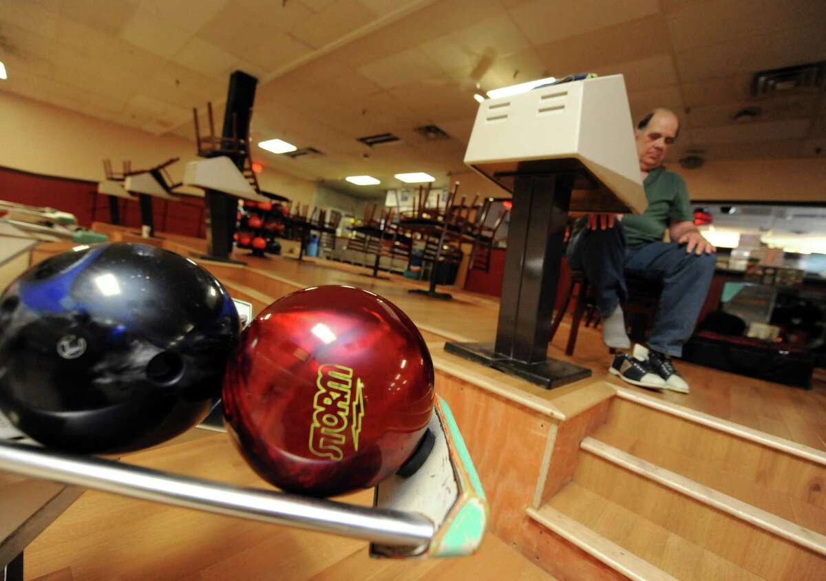 Jay Secor of Guilderland puts his bowling shoes on before bowling at Town and Country Lanes on Tuesday May 21, 2013 in Guilderland, N.Y. (Michael P. Farrell/Times Union)