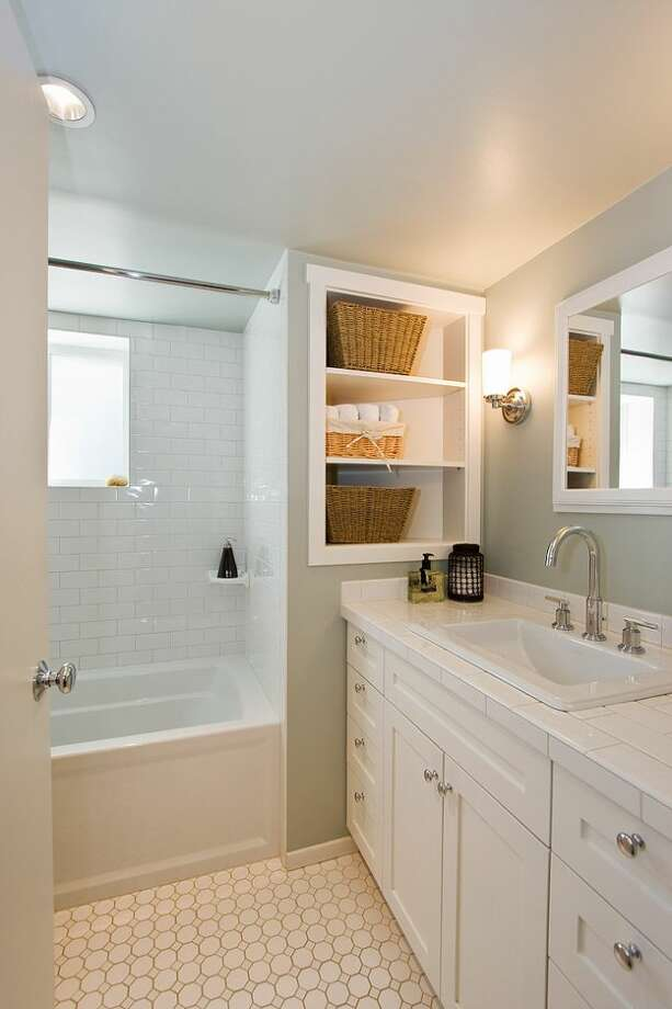 Bathroom of 2827 31st Ave. S. The 2,880-square-foot Craftsman, built in 1908, has five bedrooms and 2.75 bathrooms, including a basement apartment, box-beam ceilings and a patio on a 5,000-square-foot lot. It's listed for $699,888, although a sale is pending. Photo: Courtesy E.J. Gong, Windermere Real Estate