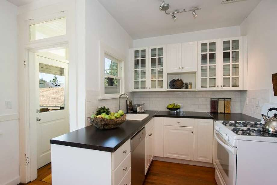 Kitchen of 2827 31st Ave. S. The 2,880-square-foot Craftsman, built in 1908, has five bedrooms and 2.75 bathrooms, including a basement apartment, box-beam ceilings and a patio on a 5,000-square-foot lot. It's listed for $699,888, although a sale is pending. Photo: Courtesy E.J. Gong, Windermere Real Estate