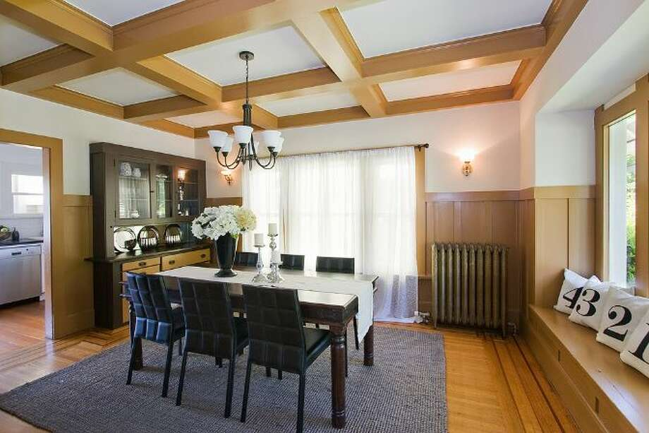 Dining room of 2827 31st Ave. S. The 2,880-square-foot Craftsman, built in 1908, has five bedrooms and 2.75 bathrooms, including a basement apartment, box-beam ceilings and a patio on a 5,000-square-foot lot. It's listed for $699,888, although a sale is pending. Photo: Courtesy E.J. Gong, Windermere Real Estate