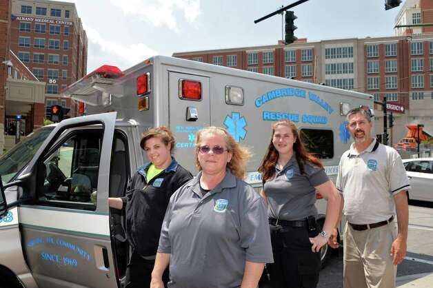 Cambridge Valley Rescue Squad members, from left, Kellie Bush, Susan Landry, Adrienne Hamilton and Capt. Mark Spiezio pose for a photo after bringing Don Armstrong, a vet who traveled to India for experimental treatments, to the Albany Medical Center emergency room in Albany, NY Tuesday May 21, 2013.  (John Carl D'Annibale / Times Union) Photo: John Carl D'Annibale / 00022496A